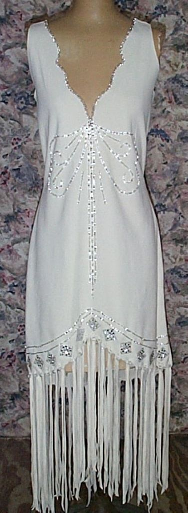 Sleeveless white deer hide dress with beadwork. http://nativeamericanstuff.net/Native%20American%20Style%20Crafted%20Clothing%20buckskins%20outfits%20moccasins%20and%20Handbags.htm