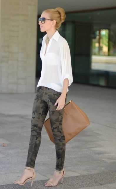 Shop this look on Lookastic:  https://lookastic.com/women/looks/button-down-blouse-skinny-jeans-heeled-sandals-tote-bag-sunglasses-necklace/12705  — Dark Brown Sunglasses  — Gold Necklace  — White Button Down Blouse  — Olive Camouflage Skinny Jeans  — Brown Leather Tote Bag  — Beige Leather Heeled Sandals