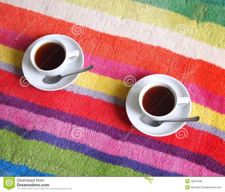 Two cup of coffee on a carpet
