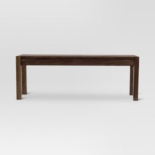 To maximize space in your dining room while adding a unique spin to traditional dining sets, reach for the Parsons Wood Dining Bench from Threshold™. This bench features a solid hardwood construction with a beautiful mahogany finish. Designed to complement your dining table as a modern seating option, it can also be used as a low coffee table — the classic design will fit well into a variety of home decors however you choose to use it.
