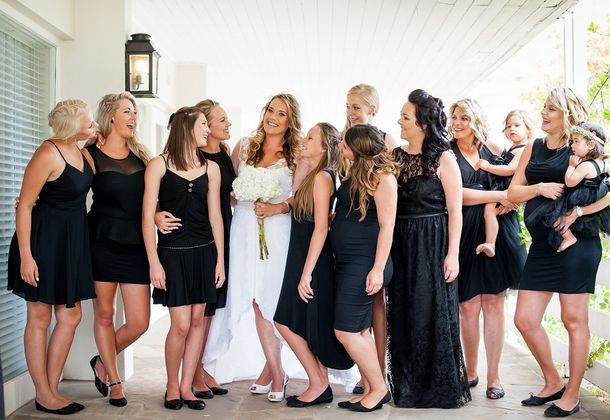Bridesmaids in little black dresses | SouthBound Bride | http://www.southboundbride.com/contemporary-carnival-wedding-at-the-quarry-by-yolande-snyders-leana-hennie | Credit: Yolande Snyders