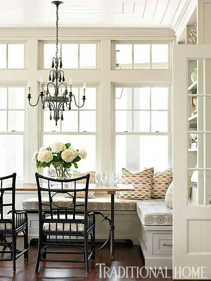 L-shaped banquette with beautiful large windows.