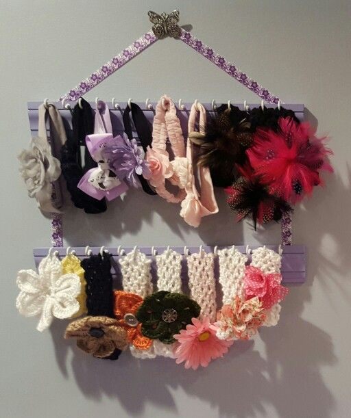 Baby headband holder. Cut down some old doorway moulding,  spray paint, add hooks,  and hang with ribbon.