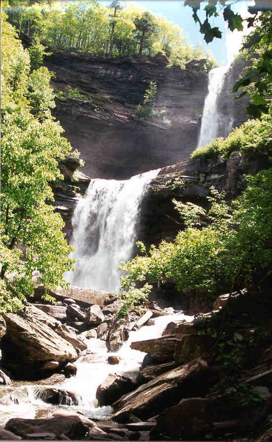 The trail to Kaaterskill Falls is located on NYS route 23A, near Palenville and Haines Falls (NY 23A is most easily reached from Thruway - I-87 - exit 21). Traveling from east to west, 3.4 miles from the intersection of NY 23A and NY 32A in Palenville, is Bastion Falls and the start of the Kaaterskill Falls Trail at a bridge. Parking is 0.2 miles further ahead, on the left (south) side of the road. This point is 1.3 miles from the intersection of NY 23A and North Lake Rd. (Greene County Rt…