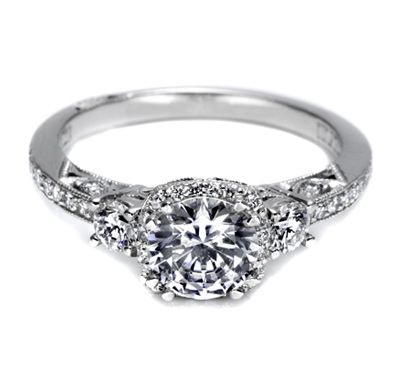 Glamorous and elegant, this three-stone Dantela ring triples the shimmer with a crown of diamonds intensifying the round center stone.