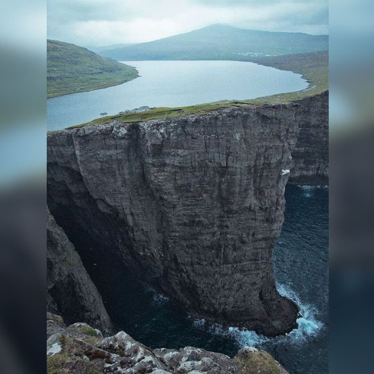 """""""Lake above an ocean..."""" - Lake Sørvágsvatn (or Lake Leitisvatn) in the Faroe Islands.  The Faroe Islands is a self-governing archipelago, part of the Kingdom of Denmark. It comprises 18 rocky, volcanic islands between Iceland and Norway in the North Atlantic Ocean."""