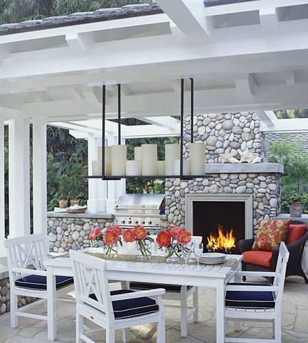 This outdoor room is a great place to unwind. It includes an integrated barbecue, hearth, and dining area—all easily accessed from multiple rooms in the home.