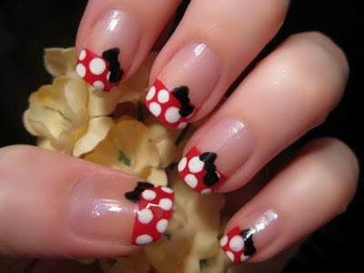 Minnie! @Sarah Lewis, you should totally have Merediths nails painted like this for her birthday!