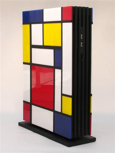 """Mondrian"" by Jeffrey Stephenson. Made from birch plywood, basswood and colored hand-cut cast acrylic tiles."