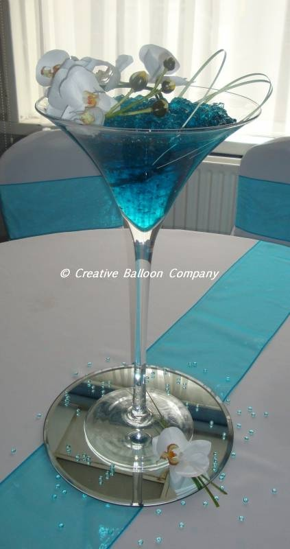 Blue water in giant martini glasses wedding pinterest