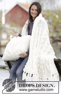 "Set consists of: Knitted DROPS blanket and pillow with cables in ""Polaris"". ~ DROPS Design"