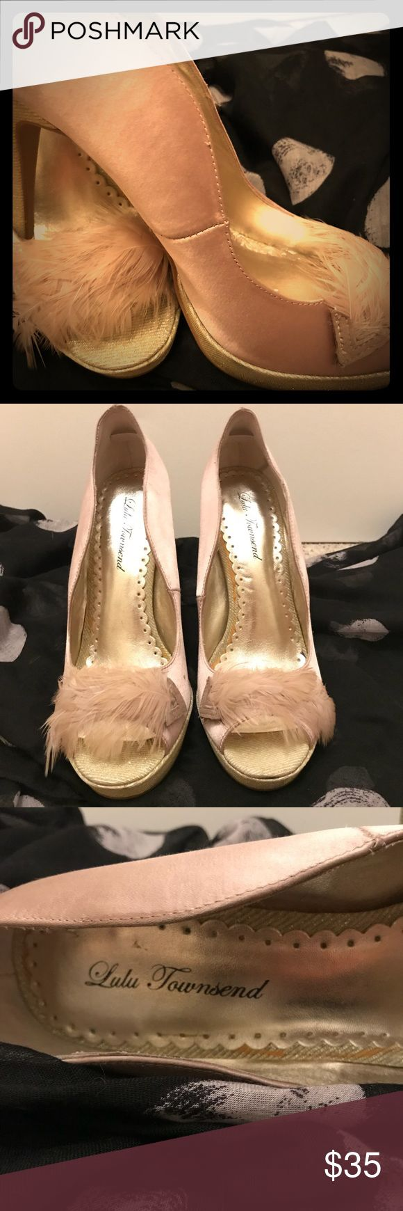 Champagne Glittery Heels Holidays are upon us and these shoes are a great way to help celebrate. Champagne colored heels with glittery gold base and heel and cream colored feather across the front. Worn in store to try on and at a friend's home just once (NYE Party). Perfect way to set off your holiday outfit Lulu Townsend Shoes Heels