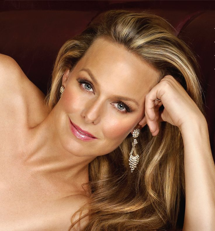 Melora Hardin.  From her gray-blue eyes, her beautiful skin tone, and the pretty soft colors she wore well in The Office, I believe Melora Hardin is a toasted soft summer, from the ColorBreeze System by Pretty Your World. She looks best in soft summer tones with a touch of warmth to them.