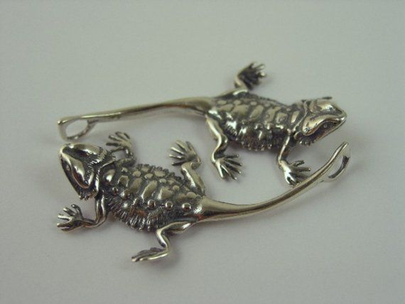 Sterling silver bearded dragon pendants.