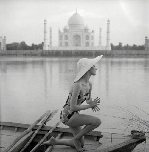 The Taj Mahal seen across the swirling Jumna River, India,...