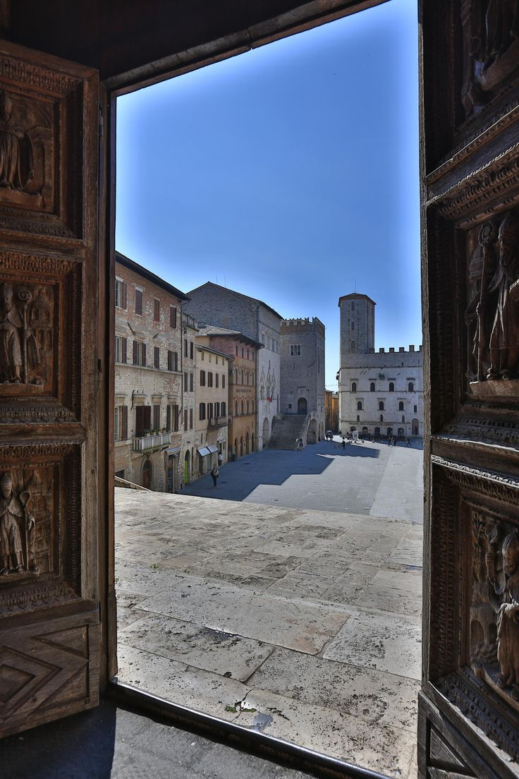 A view of Piazza del Popolo from inside de Cathedral, Umbria, Todi_ Italy
