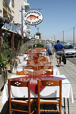 The tables of the fish tavern on the waterfront. Larnaca, Cyprus