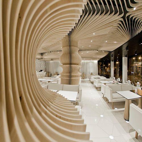 Graffiti Cafe interior by studio MODE - the wood looks amazing!