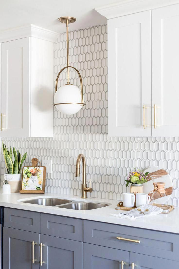 - Kitchen Backsplash With Gold Fixtures And Grey Cabinets