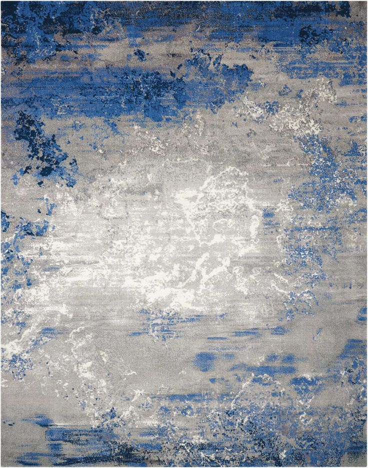 Like floating clouds in a windswept sky, the soft grey hues in this lovely area rug seem to swirl in changing formations, backlit by touches of luminous white on the field of rich Twilight blues. An evocative, chic and contemporary look for...