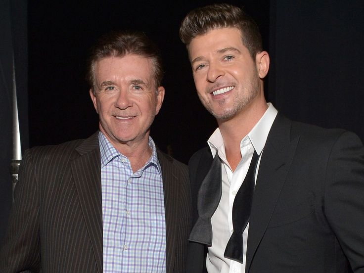 "'Golden' Parents: Robin Thicke Shares Throwback Photo of Mother Gloria Loring and Late Father Alan Thicke  Robin Thicke is paying tribute to his late father. The singer, 40, shared a sweet throwback photo of his parents, Alan Thicke and Gloria Loring, 70. Robin remembered the Growing Pains actor, writing in the caption, ""Mom and Dad looking Golden!"" Thicke died in December 2016 after suffering a hear attack while playing hockey with his youngest son, Carter. He was 69. WATCH: A Look .."