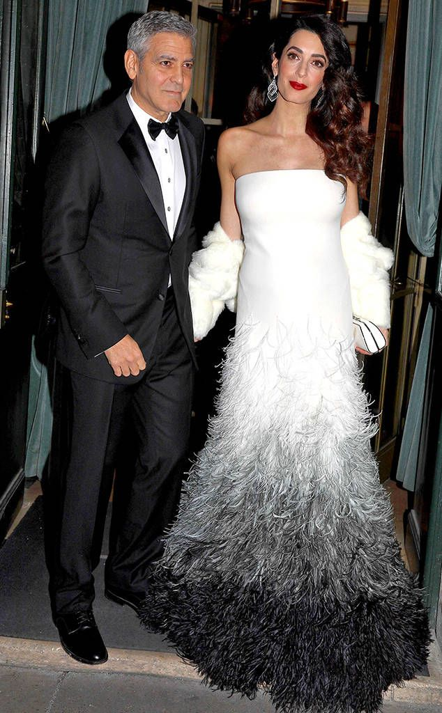 The lawyer wears a custom three-toned Atelier Versace couture feathered gown while attending the César Award with George Clooney.