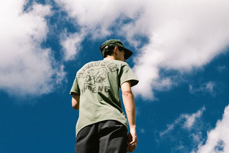 Junayd wearing our 'Tside Pocket Bear' Tee in Olive