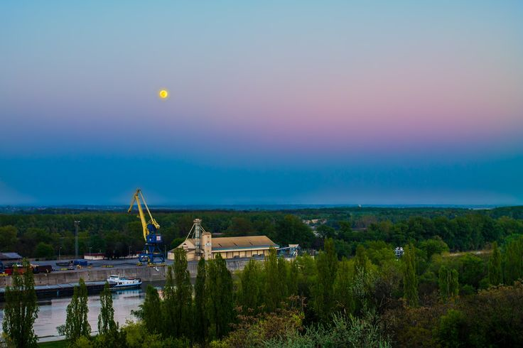Blue Hour - Shining moon above the harbor, a few minutes after sunset.