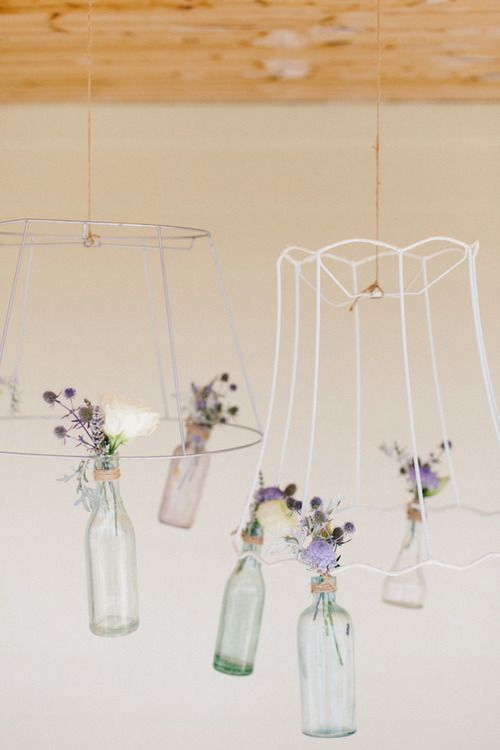 love these diy flower chandeliers of lamp shade frames with small vintage glass vases attached