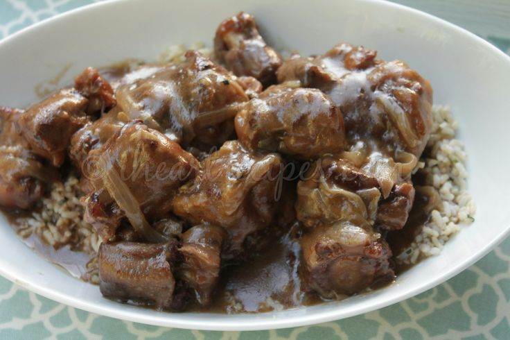 Southern, soul food style smothered oxtails. Smothered in a homemade onion and garlic gravy, and slow cooked in the Crock Pot until they are falling off the bone tender! There's something abo…