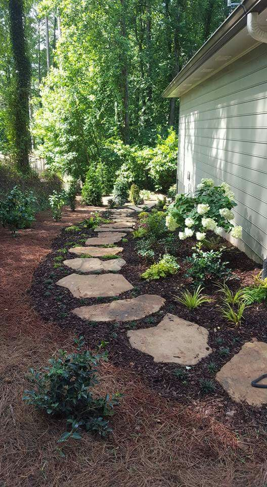 Side yard walkway between back yard fence and trash cans – Courtyards