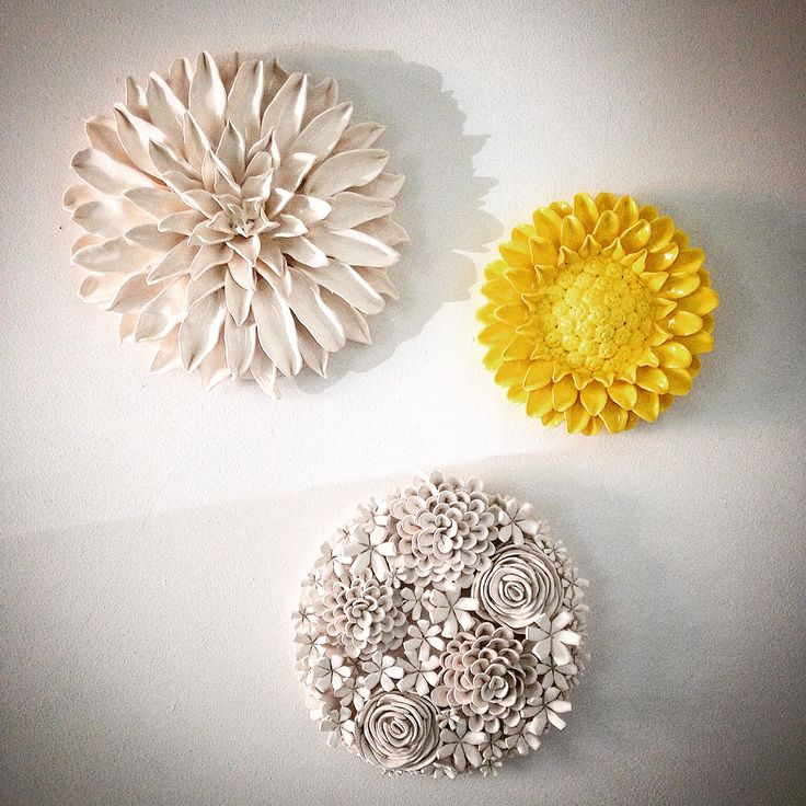 Handmade ceramic wall mounted flowers made in my studio in East London