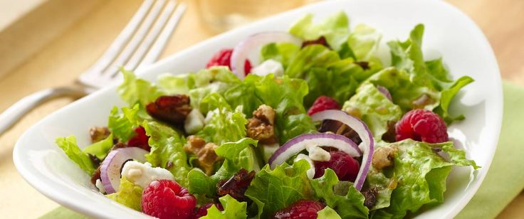 Toss together fresh greens, raspberries, crumbled goat cheese, chopped dates and candied walnuts to create a light and flavorful side salad.