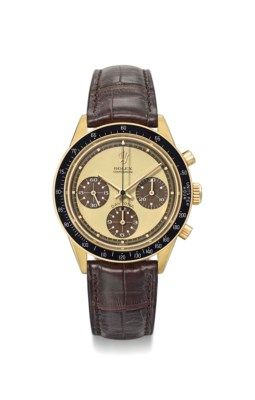 Rolex. An exceptionally rare and possibly unique 18K gold chronograph wristwatch with tropical lemon dial and white numerals inside the subsidiary dials SIGNED ROLEX, COSMOGRAPH, DAYTONA, PAUL NEWMAN MODEL, REF. 6264, CASE NO. 2'357'384, CIRCA 1970 Price realised CHF 583,500 Estimate CHF 500,000 - CHF 800,000