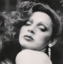 Holly Woodlawn (born October 26, 1946) is a Puerto Rican-born transgendered actress and former Warhol superstar, who appeared in his movies Trash (1970) and Women in Revolt (1972).