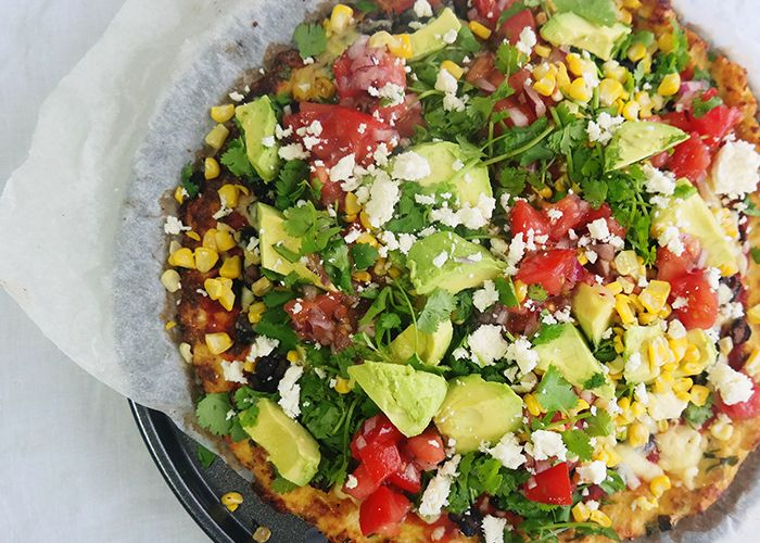 You've seen the recipes, you've heard the hype but has cauliflower pizza always seemed like a bit too much fuss? We promise that our gluten free recipe for pizza is totally worth it and we'll break it down step-by-step to keep it as simple as possible. Prepare for the taco-pizza combo of your hea...