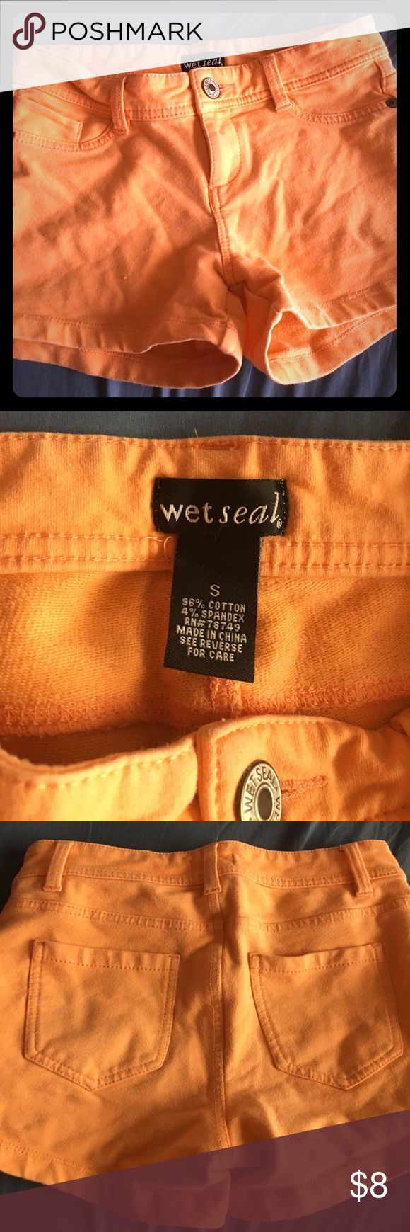 Wet Seal Peach Shorts Size Small. These shorts are a bright peach color and are pretty short. They have back pockets. The shorts are pretty stretchy. Wet Seal Shorts