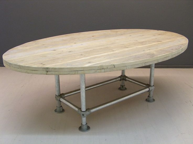 Oval table with a Kee Klamp and pipe base.