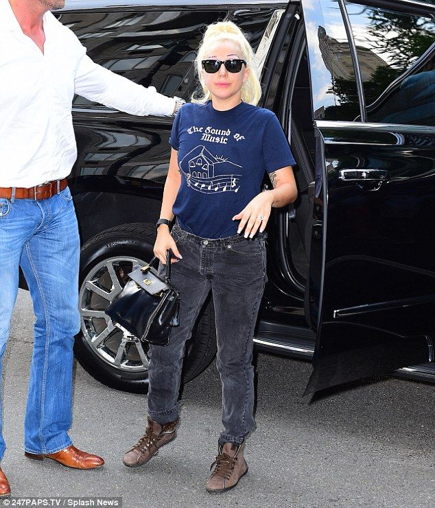 Dressed down: The singer kept it casual in a navy Sound Of Music T-shirt and faded black jeans