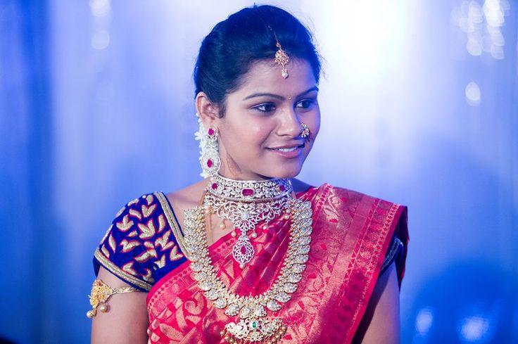 South Indian bride. Temple jewelry. Pink Silk kanchipuram sari with contrast purple blouse.Braid with fresh flowers. Tamil bride. Telugu bride. Kannada bride. Hindu bride. Malayalee bride.
