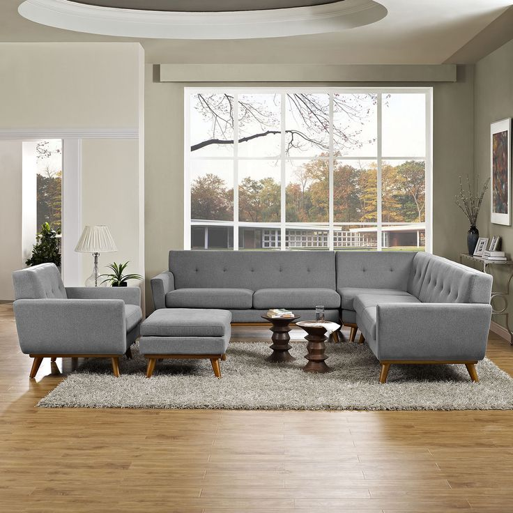 Sophisticated and elegant, this 5-piece sectional sofa combines modern style and mid-century design. Each piece features a solid base with four rubberwood legs. The classic button-tufting adds traditional charm to the rich upholstery.