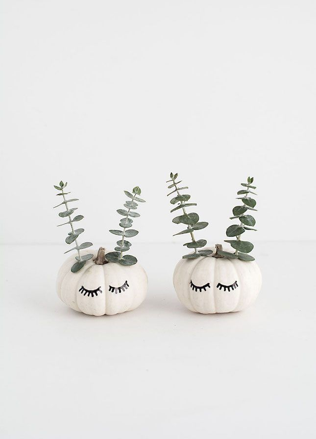 decorate your home with mini cute faced pumpkins with this halloween diy