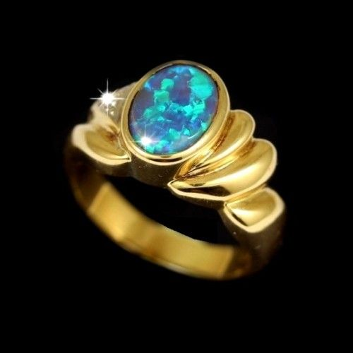 opal ring from the black opal fields of NSW Australia set in 18k yellow gold
