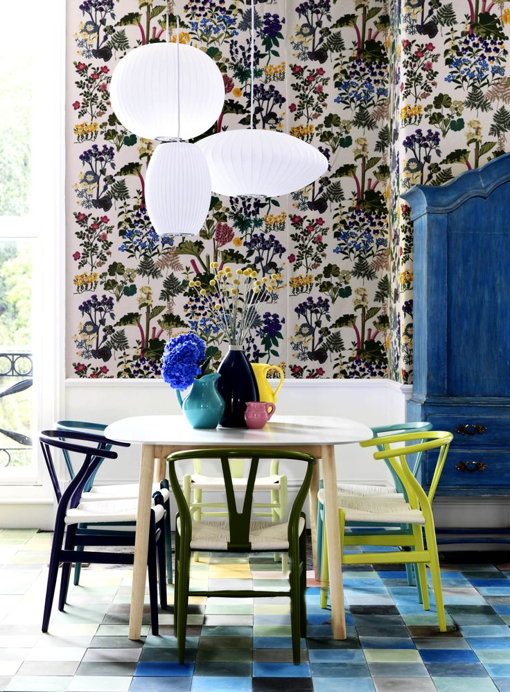 Photograph by Damian Russell for House & Garden. George Nelson lights and wall fabric 'Rhubarb' by Jobs Hantryck. #mismatched #wishbone #chairs