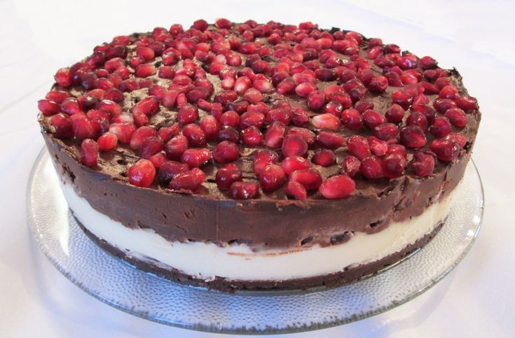 Pomegranate and Chocolate Coconut Cream Cake Recipe. I think this festive chocolate and coconut cream cake has it all. It's chocolate macaroon crust contrasts wonderfully with the smooth and sensual vanilla flavored coconut cream center. But the part that really pulls it all together and makes it wonderfully festive is its luscious topping with pomegranate seeds mixed into a thick chocolate ganache creating an awesome texture. Taste, texture and ingredients with nutrition.......