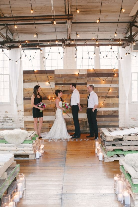 warehouse wedding with bistro string light ceremony backdrop :: decal language on the floor :: Amy Champagne Events