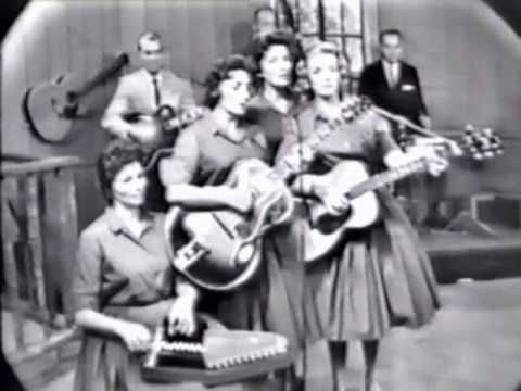 The Carter Family. Maybelle Carter, who sings lead here, was one of the pioneers who brought mountain music to the public notice. Her daughter June, who is seated, became the wife of Johnny Cash. Love the harmonies on this!