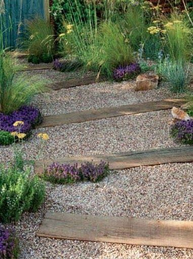 love the combination of wood and pea gravel & the beautiful plantings