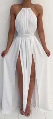 There is something magical about the double slit detail on this white maxi dress