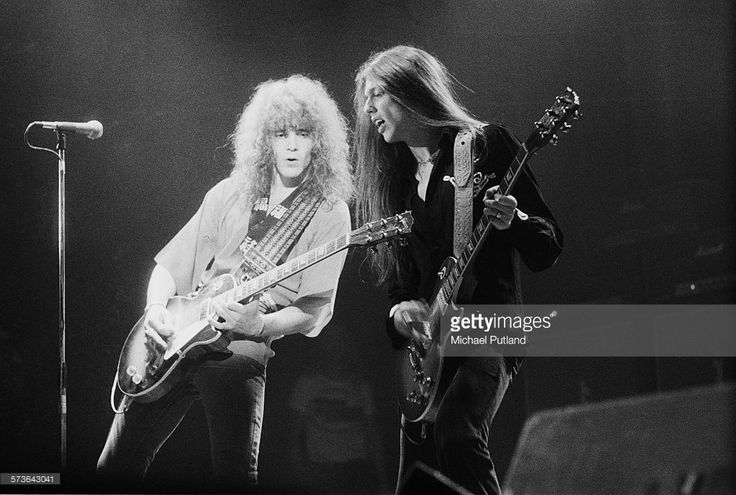 Guitarists Brian Robertson (left) and Scott Gorham performing with Irish rock group Thin Lizzy, 12th July 1976.